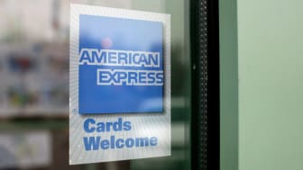 DES PLAINES, IL - NOVEMBER 11:A sign showing the American Express logo is seen outside of a restaurant November 11, 2008 in Des Plaines, Illinois. American Express won federal approval to bec