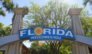 Florida Welcome You sign on archway