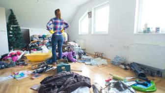 Woman decluttering house.