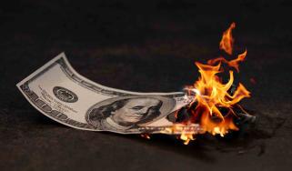 A $100 bill is on fire