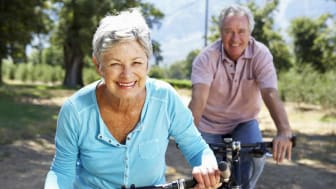 picture of retired couple riding bikes