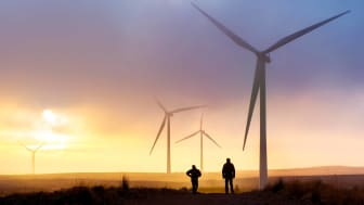 Silhouettes of windmill generators
