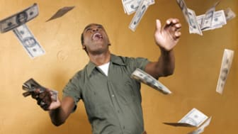 Man catching falling cash