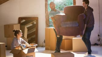 An easy chair being delivered inside a new home