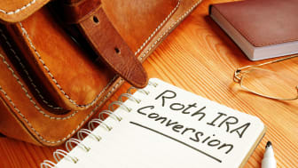 picture of notebook with Roth IRA Conversion written on it