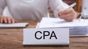picture of a CPA working at her desk