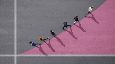 Employees follow the leader, walking in a line.
