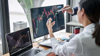 Business team investment working with computer, planning and analyzing graph stock market trading with stock chart data, business financial investment and technology concept. (Business team i