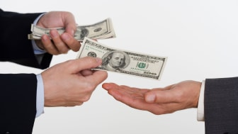 picture of one person handing money to another person
