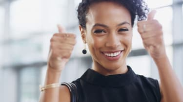 A woman gives two thumbs up