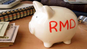 "picture of a piggy bank with ""RMD"" written on the side"