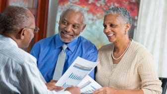 picture of an elderly couple discussing finances with an advisor