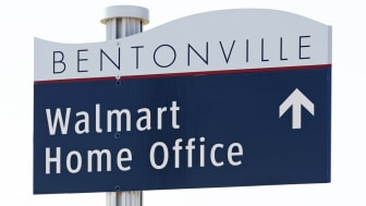 Bentonville, Arkansas, USA aa October 4, 2012: A sign points the way to the Walmart Home Office in Bentonville. The Walmart Home Office is the world headquarters of the retail giant.