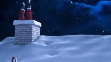 Santa Claus stuck in a chimney on a roof on Christmas night with snowfall.