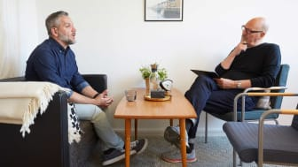 A man talks with a therapist