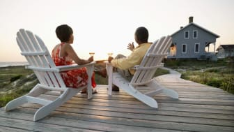 picture of couple sitting outside of vacation home