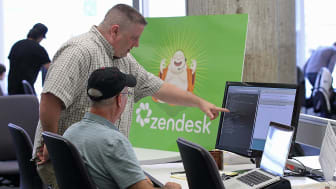 Zendesk worker helping out another person