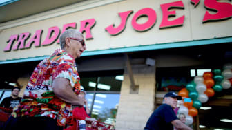 PINECREST, FL - OCTOBER 18: Shoppers lineup as they wait for the grand opening of a Trader Joe's on October 18, 2013 in Pinecrest, Florida. Trader Joe's opened its first store in South Florid