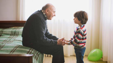 A grandfather has a heart-to-heart talk with his grandson.
