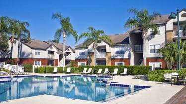 Condominium complex in the tropics with swimming pool, palmj trees and lush tropical foliage.