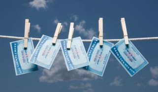 Social Security Cards pinned on a clothesline.