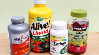 Four containers of vitamins