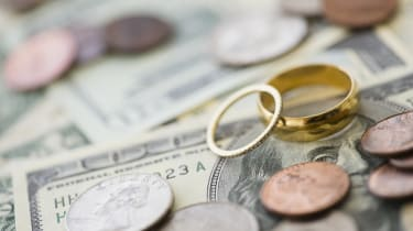 Close up of wedding rings with money