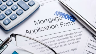 proved Mortgage application form with a calculator and pen