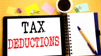 """picture of an open notebook with """"Tax Deductions"""" written on a page"""