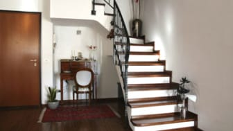 Interior decoration of a room with stairs and antique desk
