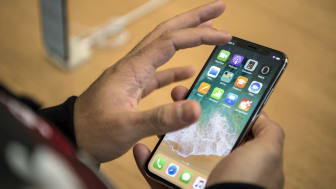 LONDON, ENGLAND - NOVEMBER 03:A customer views the iPhone X upon its release in the U.K on November 3, 2017 in London, England. The iPhone X is positioned as a high-end, model intended to sho