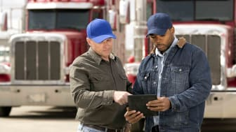 two truck drivers having a meeting