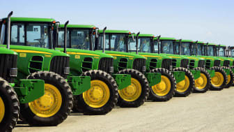 Line of heavy equipment vehicles ready to be auctioned off