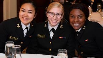 picture of three female Naval Academy midshipmen