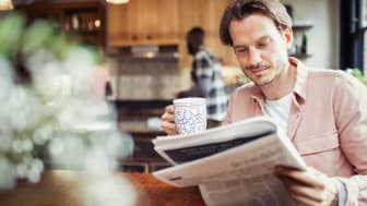 Photo of person reading newspaper