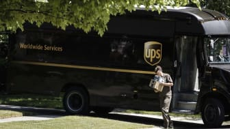 Rochester, Michigan, USA - June 08, 2016: A UPS driver making a delivery to a residence in Rochester.