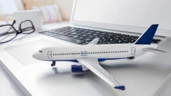 model plane next to laptop