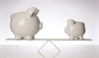 piggy banks on a balance