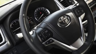 St-Petersburg, Russia - May 12, 2016: Car wheel and dashboard, closeup photo with selective focus, Interior of luxury Japan crossover Toyota Highlander third generation, model of 2014 year