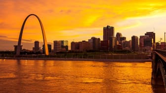 The Gateway Arch in St. Louis, Missouri as seen in a cityscape at sunset