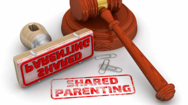 """picture of judges gavel and a rubber stamp that says """"shared parenting"""""""