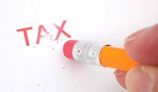 """picture of the word """"tax"""" being erased by a pencil eraser"""