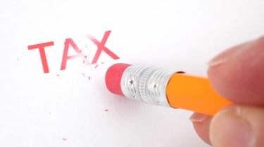 "picture of the word ""tax"" being erased by a pencil eraser"