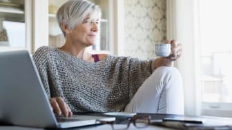 picture of elderly woman drinking coffee at home