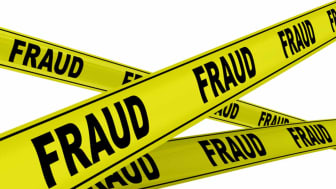 """Yellow warning tapes with inscription """"FRAUD"""". Isolated"""