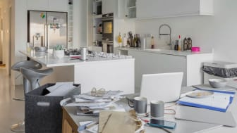 A cluttered kitchen in daylight