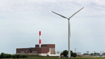 MARSEILLES, IL - JUNE 14:A power generating windmill towers above a nuclear power plant operated by Exelon on June 14, 2018 near Marseilles, Illinois. Driven by falling costs, global spending