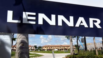 A large Lennar banner hangs in front of one of the homebuilder's developments