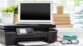 Printer and laptop on office table