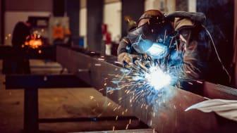 welder working on steel beam
